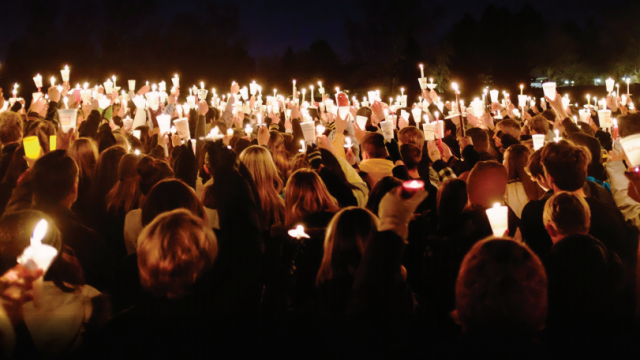 Photo of people holding candles for vigil